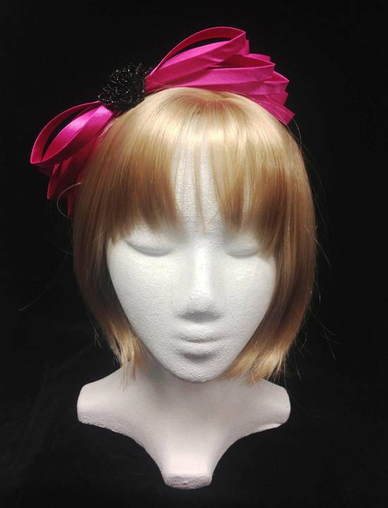 Fuchsia satin fascinator with black jet rose