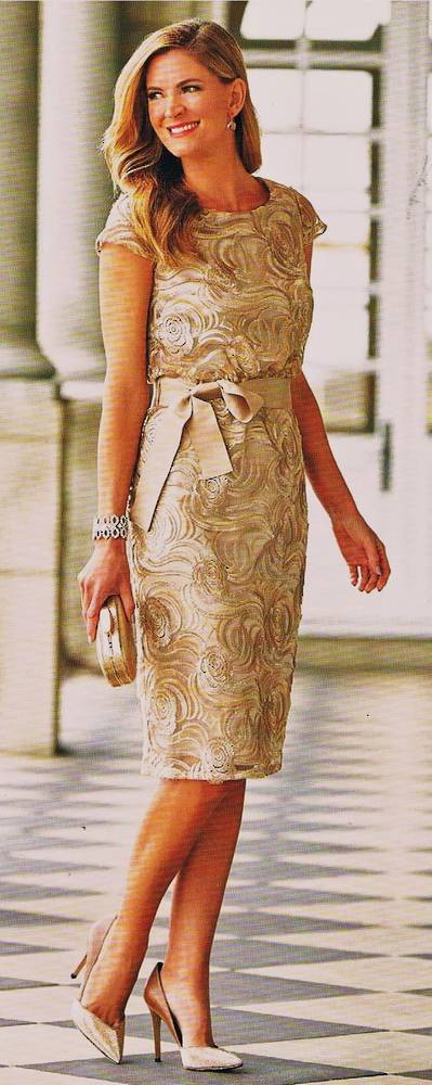 Gold embossed dress over a sand lining