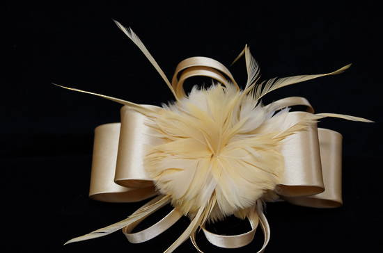 Gold satin double bow with feathers fascinator