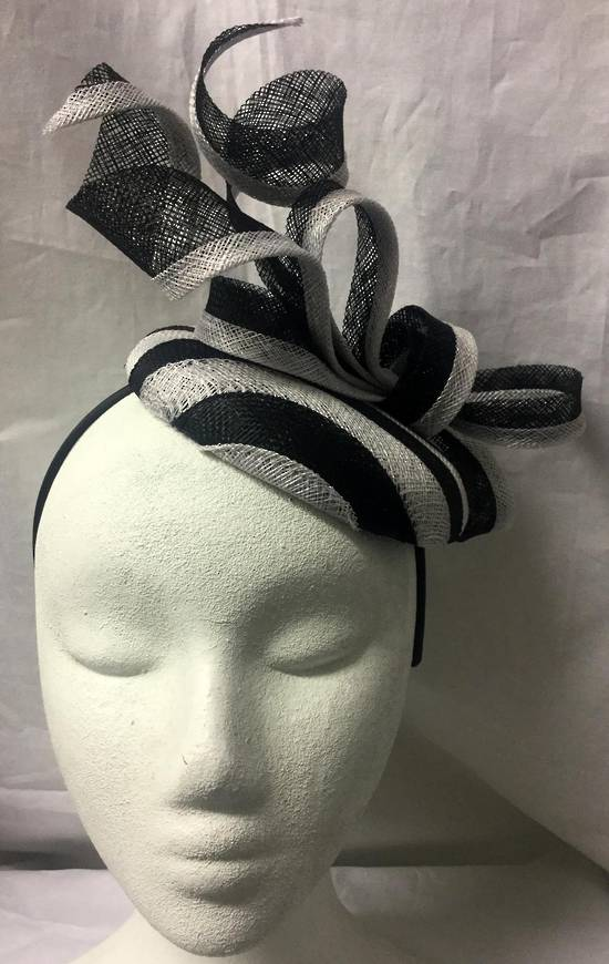 Black and white stripe pillbox hat on a headband