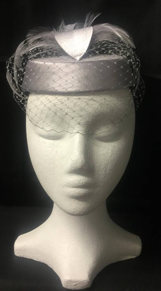 Silver pillbox hat with veiling