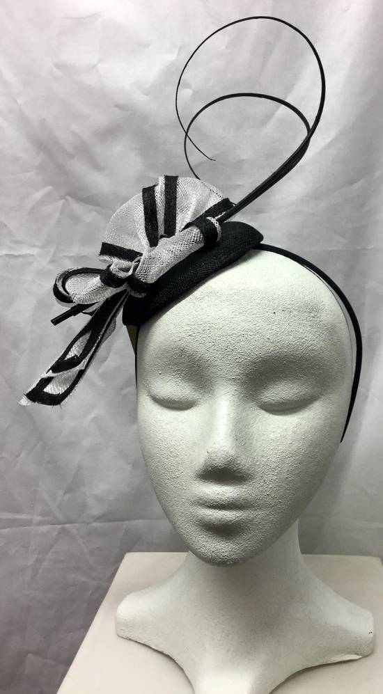 White and black two tone fascinator with curly sticks