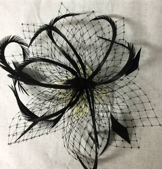 Black fascinator with veiling and feathers