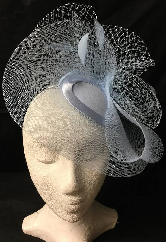 Powder blue cocktail hat with veiling and feathers