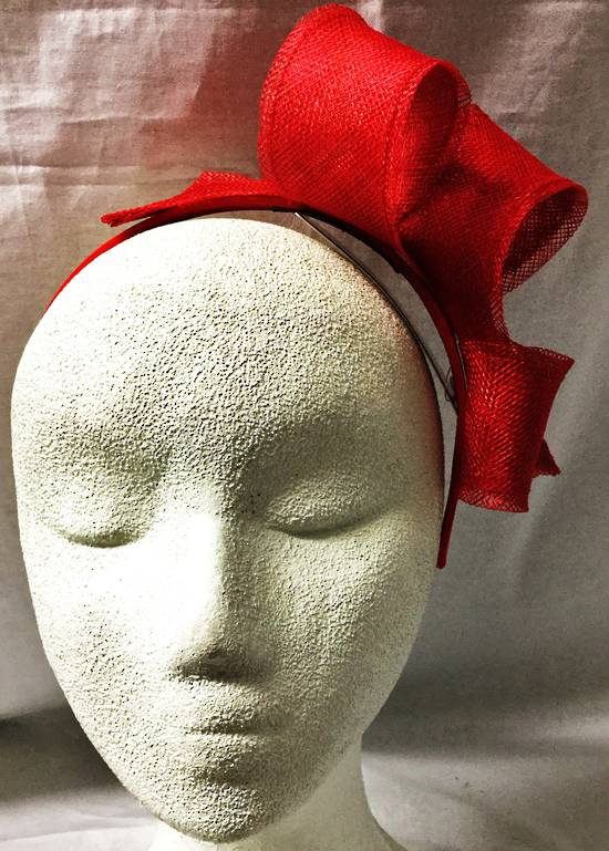 Red looped fascinator on a headband
