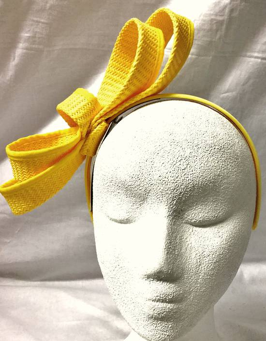 Yellow looped fascinator on headband