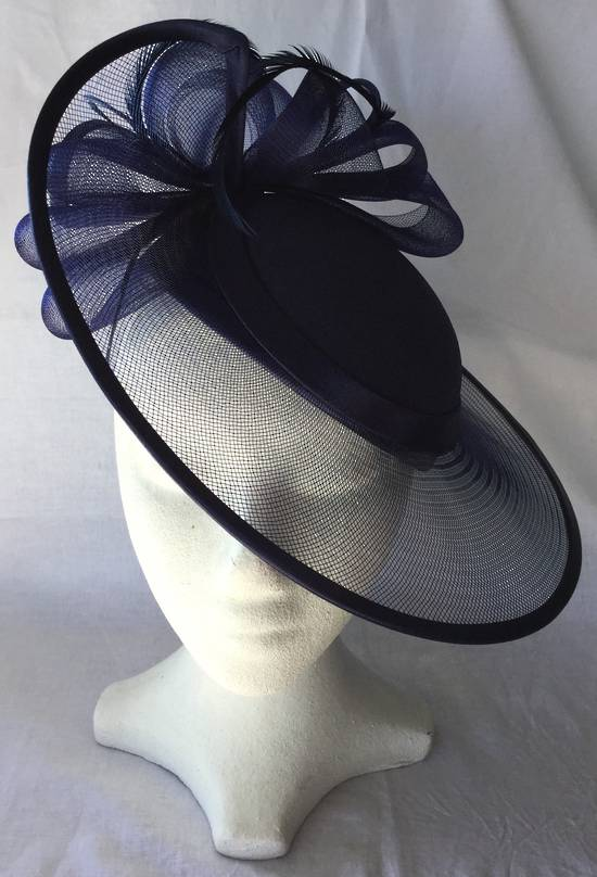 Navy hat with satin binding, loops and feathers - one only