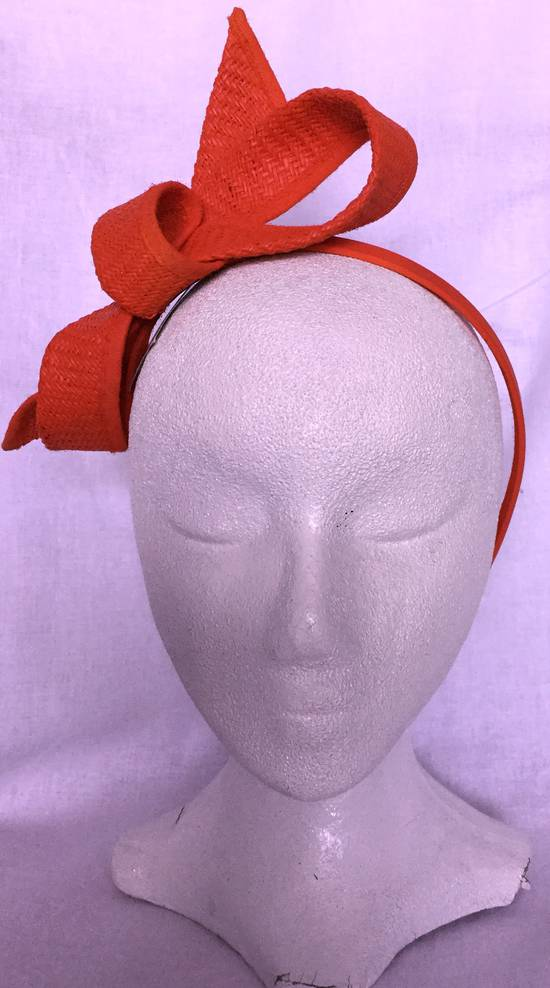 Tangerine (burnt orange) looped fascinator on headband - one only