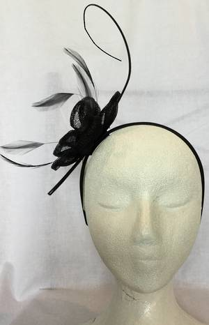 Black flower fascinator with curling stick - one only