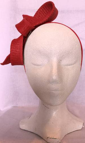 Red looped fascinator on headband - one only