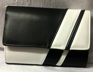 Black and white asymmetrical stripe clutch bag