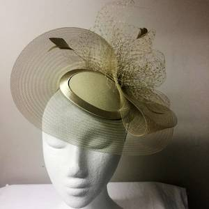 Antique gold cocktail hat with veiling and feathers