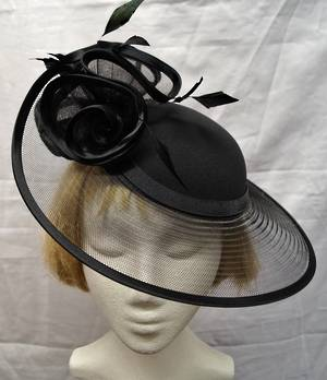 Black hat edged in satin forming rosettes