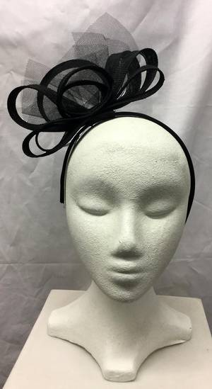 Black multi looped fascinator on a headband