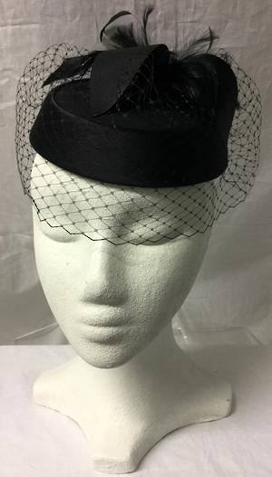 Black pillbox hat with veiling