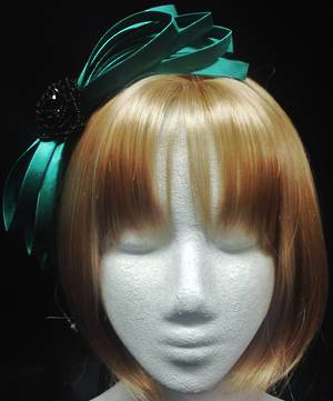 Emerald green satin fascinator with black jet rose