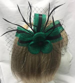 Emerald green fascinator with black stripe, feathers and mesh
