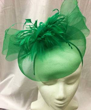 Emerald green fascinator with feather flower on a headband