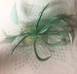 Mint fascinator with veiling and feathers