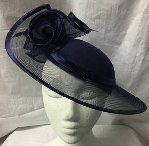 Navy hat edged in satin forming rosettes