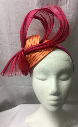 Orange and fuchsia ribbon knot fascinator