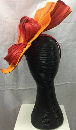 Orange and red fan shaped asymmetrical hat with swirl