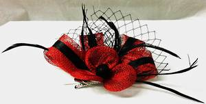 Ruby red fascinator with black stripe, feathers and mesh