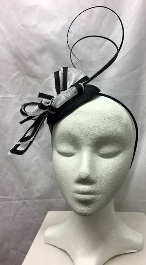 Black and winter white two tone fascinator with curly sticks