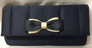 Navy and nude clutch bag