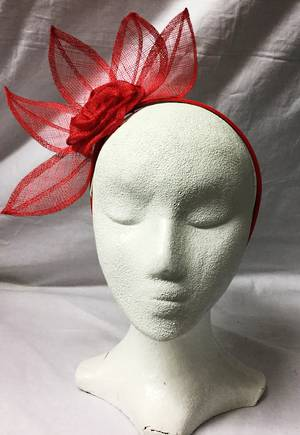 Red fascinator with leaf design and rosette