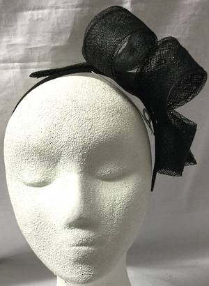 Black looped fascinator on a headband