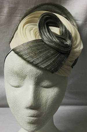 Cream and silver cocktail hat