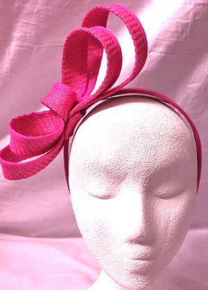 Fuchsia looped fascinator on headband