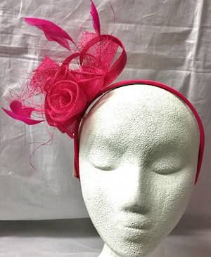 Fuchsia rosette and feather fascinator