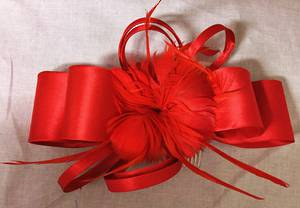 Red satin double bow with feathers fascinator