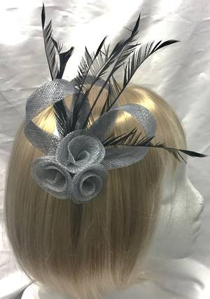 Silver small fascinator with black feathers, loops and rosette design