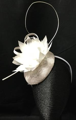 Ivory fascinator with spikey feather flower