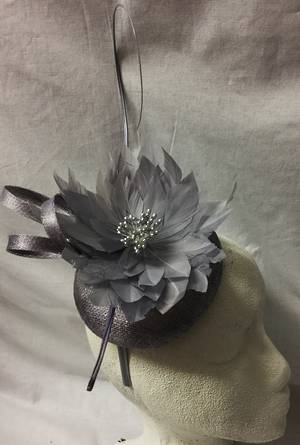 Lilac fascinator with spikey feather flower
