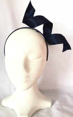 Navy (ink) twist fascinator on a headband