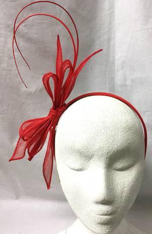 Red fascinator with bows and curly sticks