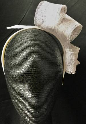 White looped fascinator on a headband