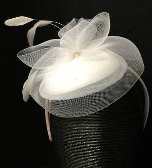 White small cocktail hat on headband