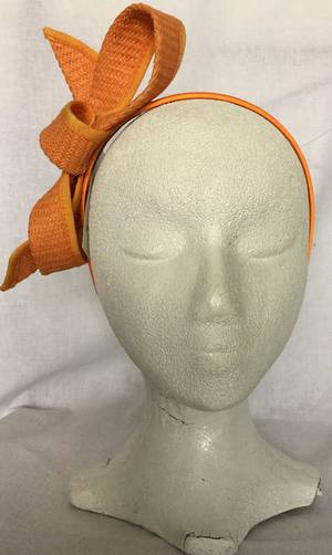 Orange looped fascinator on headband - one only