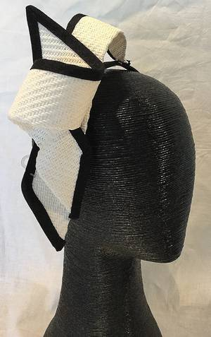 White twist fascinator edged in black