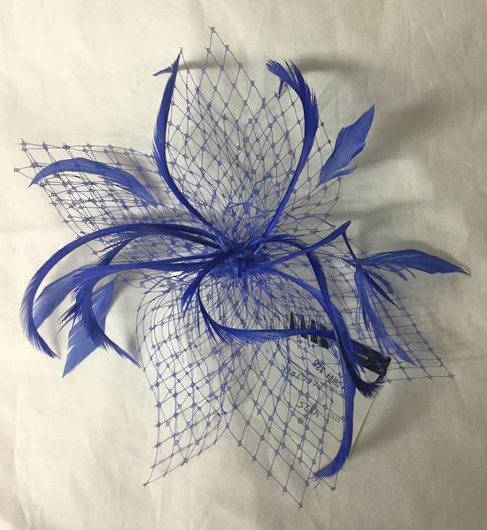 Electric blue fascinator with veiling and feathers