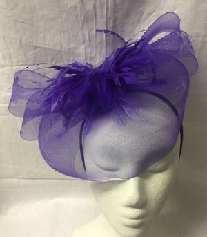 Purple fascinator with feather flower on a headband