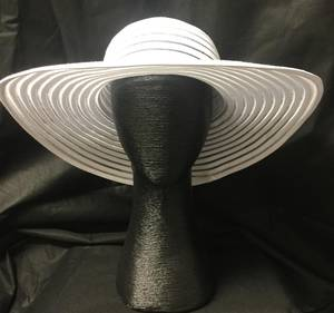 Large white hat with ribbon look brim