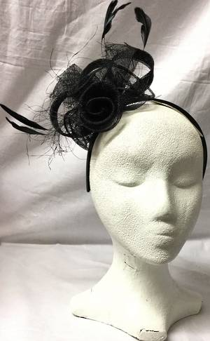 Black rosette and feather fascinator