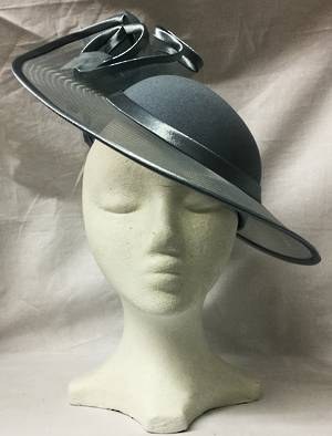 Steel hat edged in satin forming rosettes