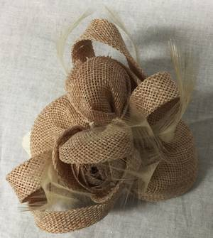 Nude fascinator with feather detail and rosebud